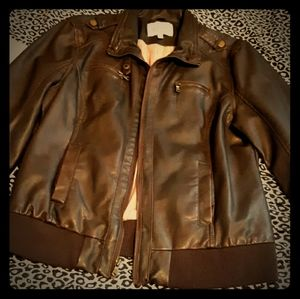Delia's brown leather jacket